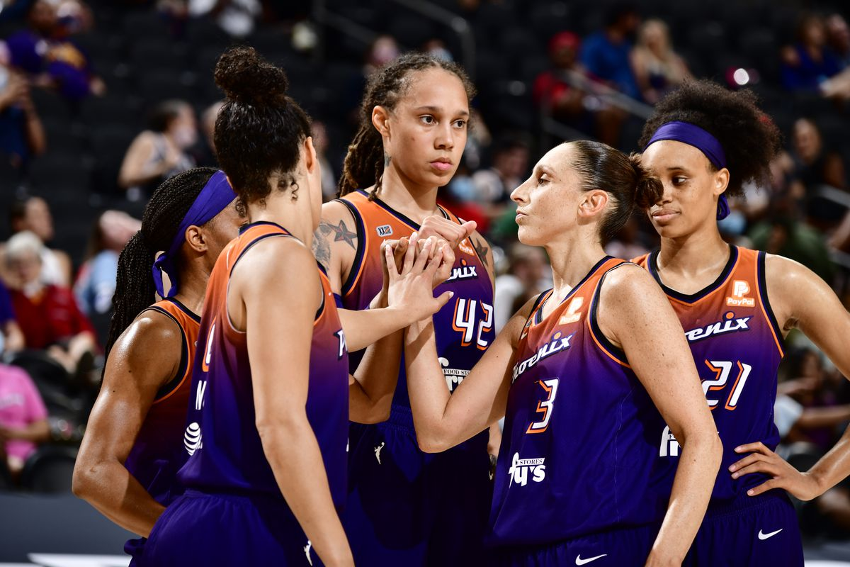 Brittney Griner #42, Diana Taurasi #3 of the Phoenix Mercury and teammates huddle up during the game against the Indiana Fever on August 17, 2021 at Footprint Center in Phoenix, Arizona.