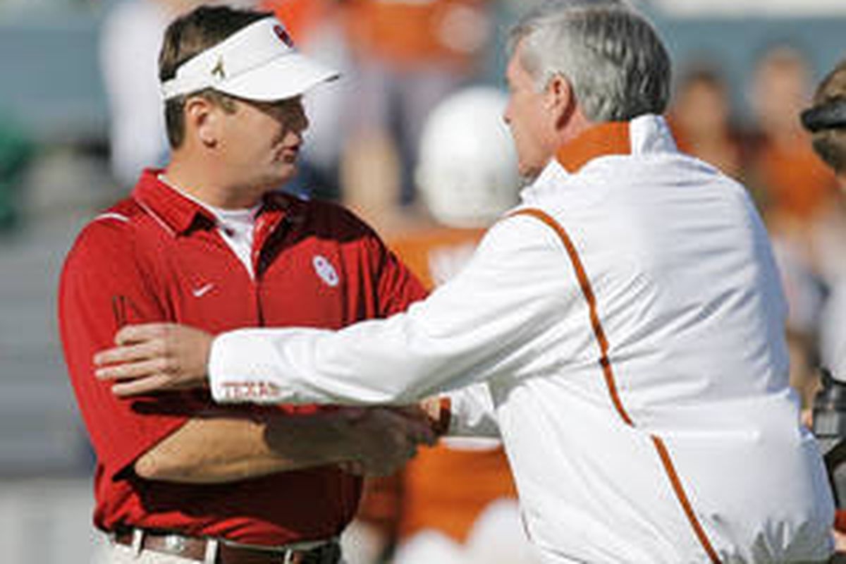 Oklahoma's Bob Stoops (left) and Texas' Mack Brown at this year's Red River Rivalry in Dallas.