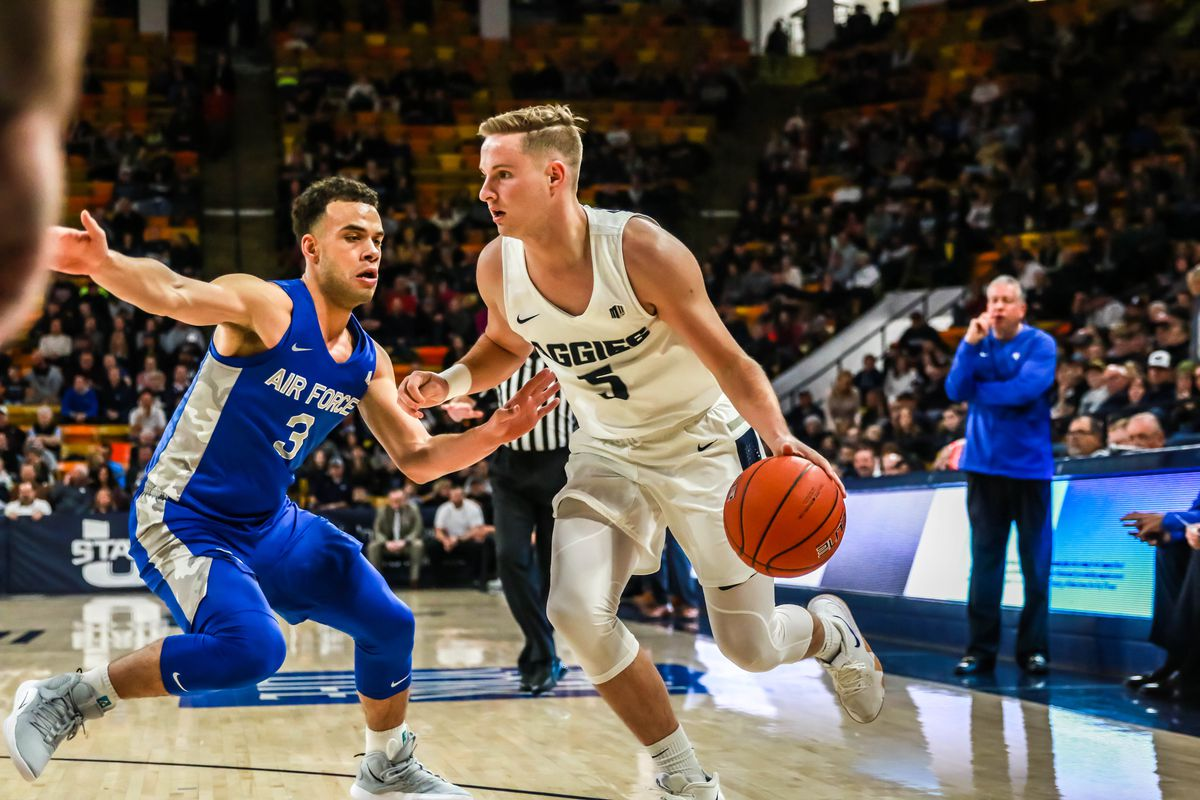 Utah State guard Sam Merrill makes a move against an Air Force defender in a January game at the Dee Glen Smith Spectrum in Logan, Utah.