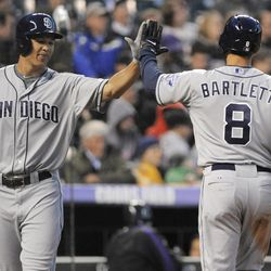San Diego Padres' Jason Bartlett (8) is congratulated by Will Venable after scoring on a Cameron Maybin single off Colorado Rockies starting pitcher Jeremy Guthrie during the fourth inning of a baseball game, Monday, April 16, 2012, in Denver.