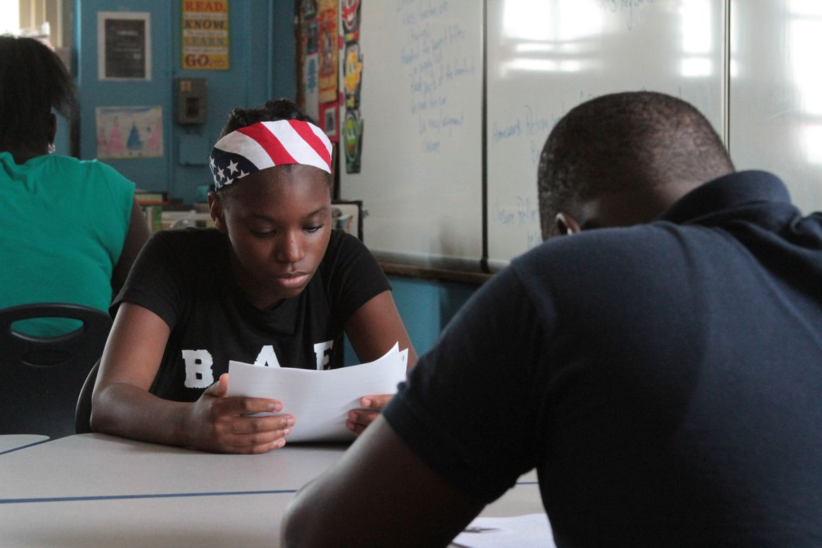 A seventh-grade student attends the first day of school at the School of Diplomacy in the Bronx.