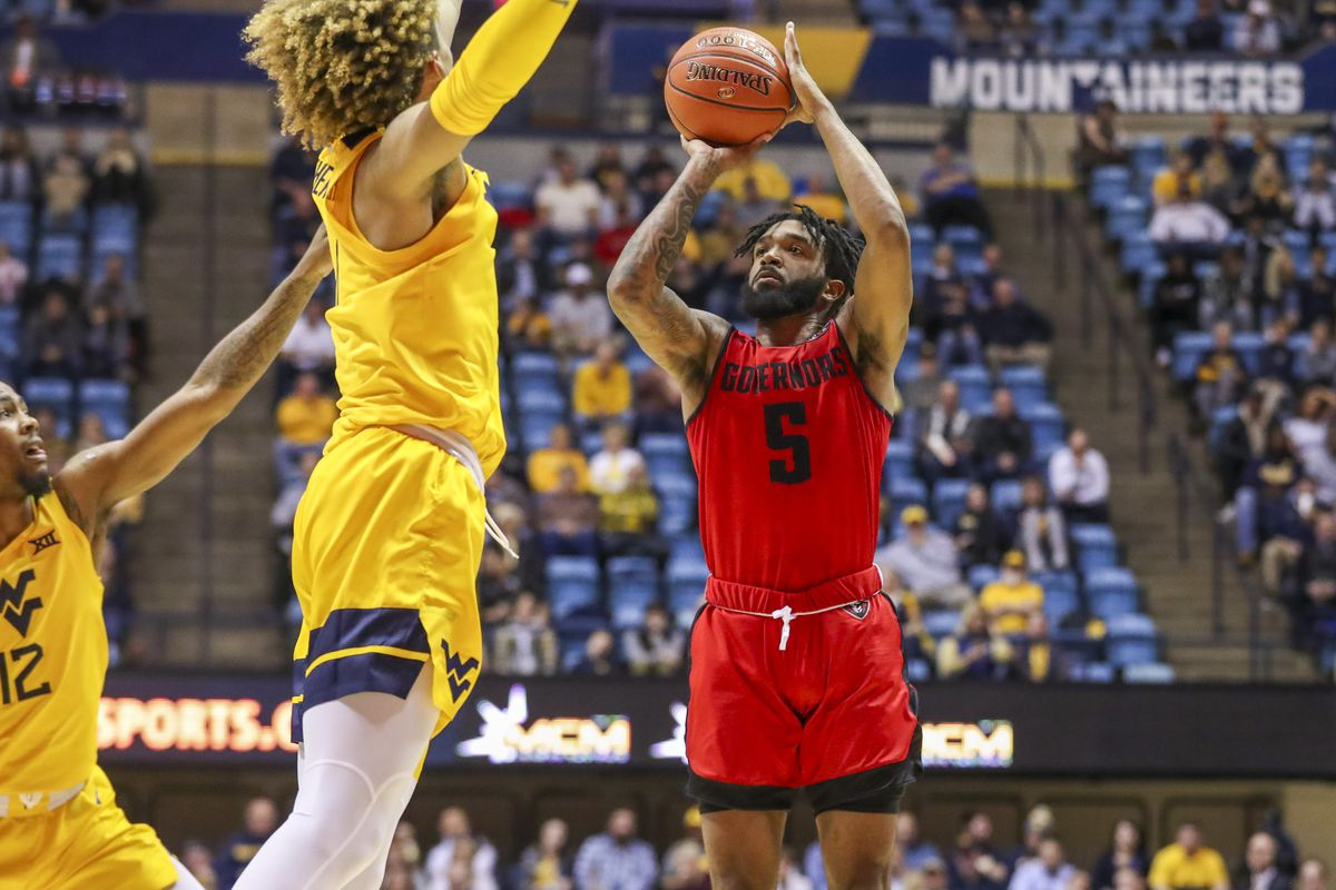 Austin Peay Governors guard Jordyn Adams shoots the ball over West Virginia Mountaineers guard Taz Sherman and Mountaineers forward Emmitt Matthews Jr. during the first half at WVU Coliseum.