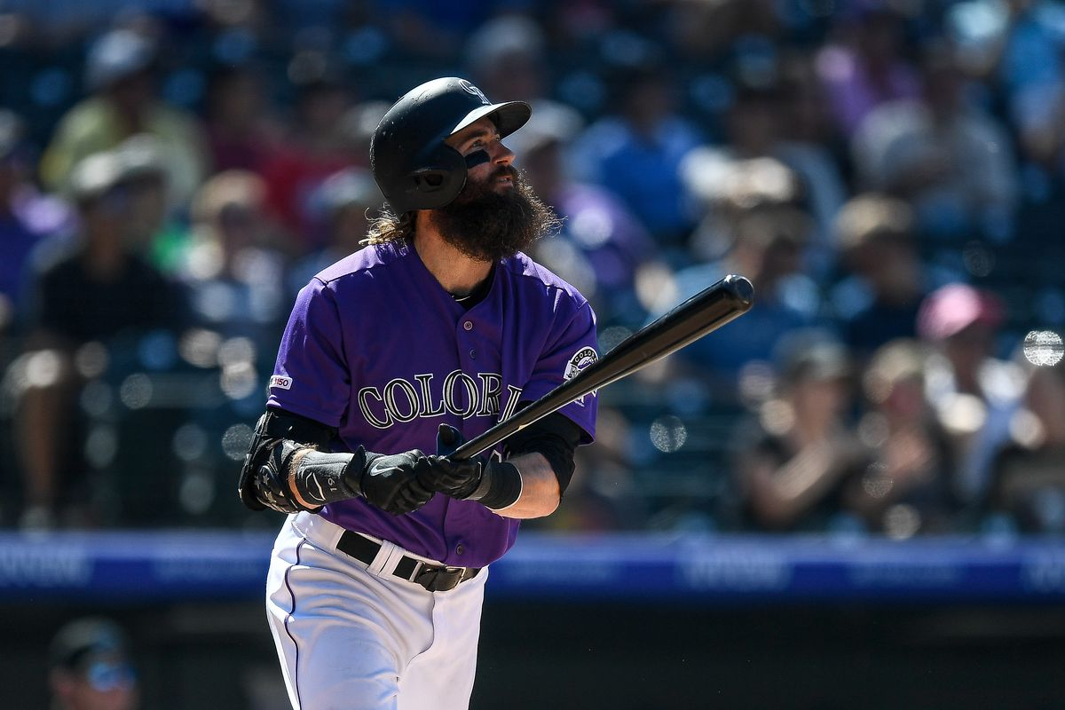 Charlie Blackmon #19 of the Colorado Rockies follows the flight of a sixth inning solo home run against the Miami Marlins at Coors Field on August 18, 2019 in Denver, Colorado.