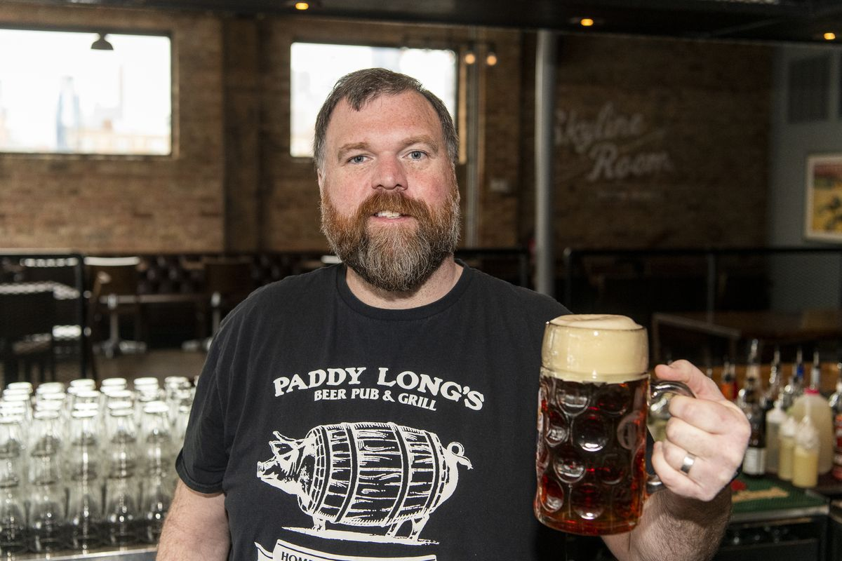 Patrick Berger holds a mug of Great Central Fastenbock, a beer he's been surviving on for Lent, at Kaiser Tiger, Friday morning, March 6, 2020.