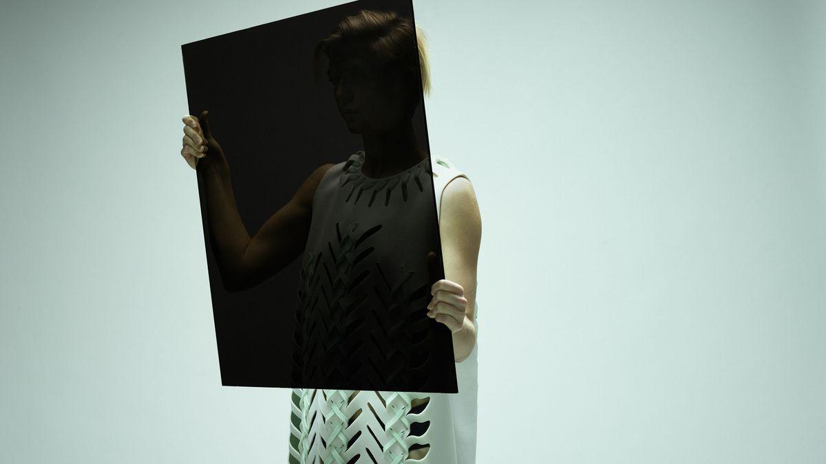 Woman looking in dark mirror