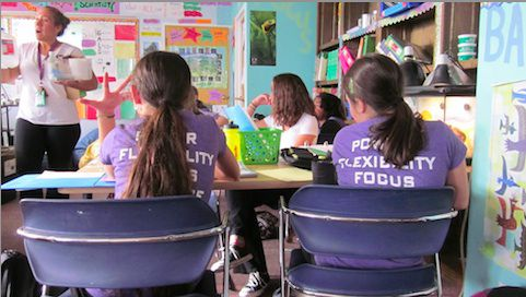 Students in class at GALS wearing GALS T-shirts, which is part of the charter school's dress code.