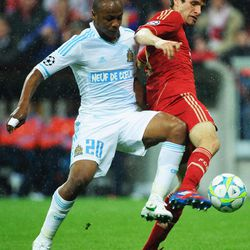 Munich's  Thomas Mueller, right, and Marseille's  Andre Ayew challenge for the ball during the  Champions League quarterfinal second leg soccer match between FC Bayern Munich and Olympique de Marseille in Munich, Germany, Tuesday, April 3, 2012.