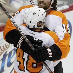 Philadelphia Flyers' Scott Hartnell (19) celebrates his first-period goal with Danny Briere (48) against the Pittsburgh Penguins during Game 5 of an opening-round NHL Stanley Cup hockey playoff series in Pittsburgh Friday, April 20, 2012.