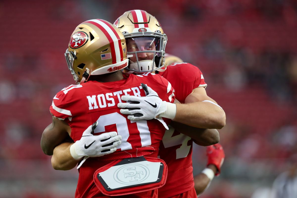 San Francisco 49ers fullback Kyle Juszczyk hugs running back Raheem Mostert before the start of the game against the Los Angeles Rams at Levi's Stadium.