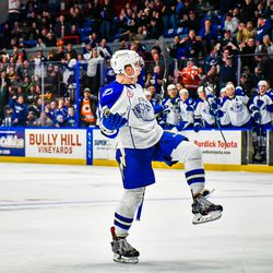 Syracuse Crunch Ross Colton (22) celebrates his goal against the Wilkes-Barre/Scanton Penguins in American Hockey League (AHL) action at the War Memorial Arena in Syracuse, New York on Saturday, December 22, 2018. Syracuse won 4-3 in OT.