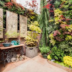 """Seven original Japanese paintings, re-imagined as garden art embedded in burnished silver leaf, were the inspiration for the space, which is called the 'Birds of Prey Garden Courtyard' [Photo by <a href=""""http://www.patriciachangphotography.com/"""">Patricia"""