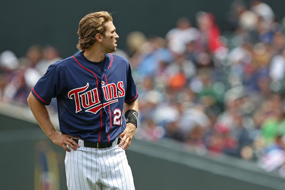 May 30, 2012; Minneapolis, MN, USA: Minnesota Twins shortstop  Brian Dozier (20) looks on during the eighth inning against the Oakland Athletics at Target Field. The Twins won 4-0. Mandatory Credit: Jesse Johnson-US PRESSWIRE