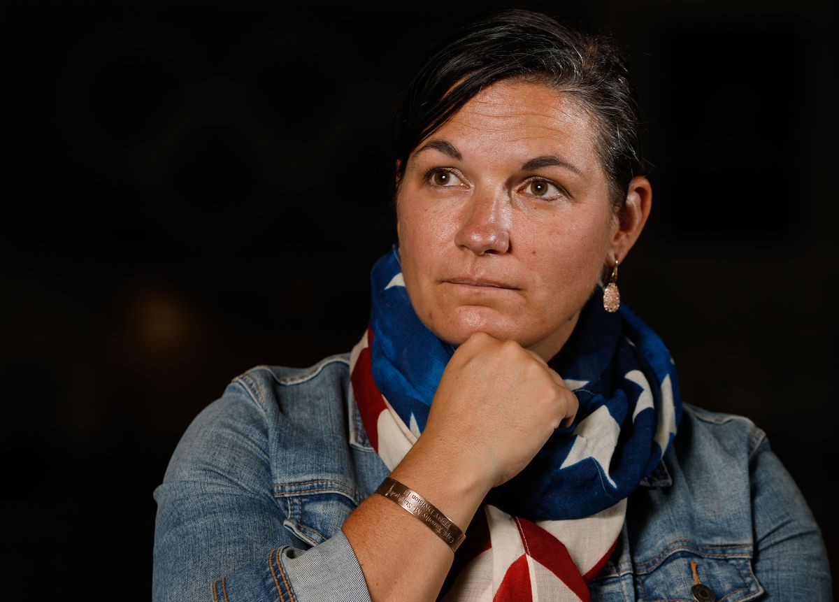 Catherine Raney Norman, Olympic speed skater and Salt Lake City Committee for the Games bid leader, poses for a portrait at Utah Olympic Oval in Kearns on Saturday, Aug. 28, 2021, while wearing a bracelet she wore while competing in the 2002 Winter Games bearing the name of a New York City firefighter killed in the 9/11 attacks.