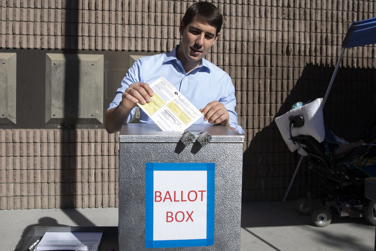 Democratic candidate for California's 10th Congressional District Josh Harder places his ballot inside a ballot box