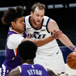 Utah Jazz forward Joe Ingles (2) dribbles against Phoenix Suns forward Cameron Johnson (23) during an NBA preseason game at Vivint Smart Home Arena in Salt Lake City on Saturday, Dec. 12, 2020.