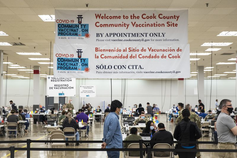 People line up for COVID-19 vaccine doses Thursday at Cook County's Forest Park Community Vaccination Site at 7630 Roosevelt Road in Forest Park. About 2.6 million Illinois residents have been fully vaccinated so far, or about 20% of the population.