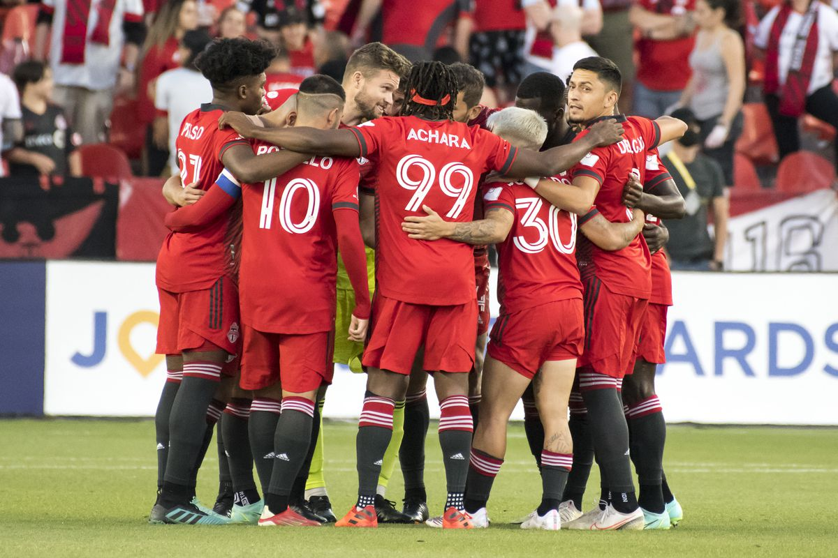 Toronto FC players in action during the MLS game between...