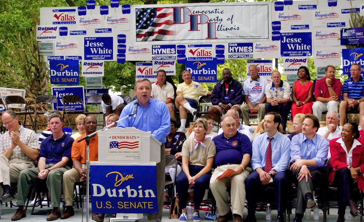 U.S. Sen. Dick Durbin is surrounded by Illinois Democrats as he leads a rally during Democratic Day at the Illinois State Fair in 2001.