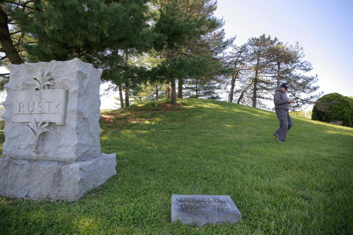 In this April 10, 2012, photo, Ken Tankersley, an assistant professor of anthropology at the University of Cincinnati, walks down the American Indian mound at the Oddfellow Cemetery in Newtown, Ohio. The cemetery is now called the Flagg Spring Cemetery an