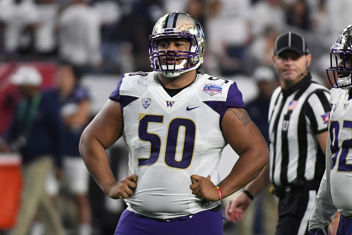 70839488f Bears first round pick Vita Vea pulls back on his shirt to accentuate his  ursine belly.