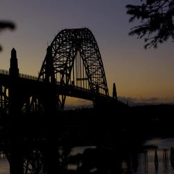 This Sept. 28, 2011, photo shows the Yaquina Bay Bridge, Newport, Ore. A woman who appealed for money online to help care for her autistic son and disabled husband has been accused of throwing her 6-year-old boy to his death off the historic bridge on Monday, Nov. 3, 2014.