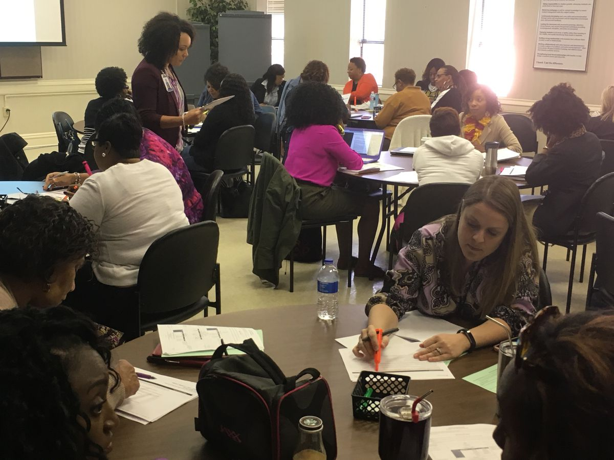 Rachelle Taylor (standing) leads elementary school teachers in a training on Expeditionary Learning, a new curriculum for English language arts being introduced in Shelby County Schools.