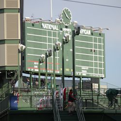 3:54 p.m. Scaffolding set up in back of the bleachers, and broadcast camera in the left field corner -