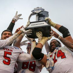 Utah Utes raise the Zaxby's Heart of Dallas Bowl Champions Trophy after beating the West Virginia Mountaineers 30 to 14 in Dallas Texas on Tuesday, Dec. 26, 2017.