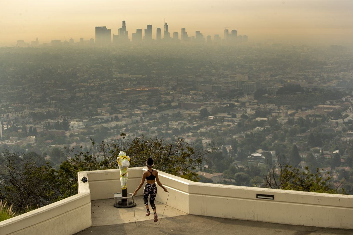 Los Angeles resident Carmen Green jumps rope at a closed Griffith Observatory where she found a quiet nook to exercise in spite of dense smoke from Southern California wildfires choking the L.A. Basin on Thursday, Sept. 17, 2020 in Los Angeles, CA.