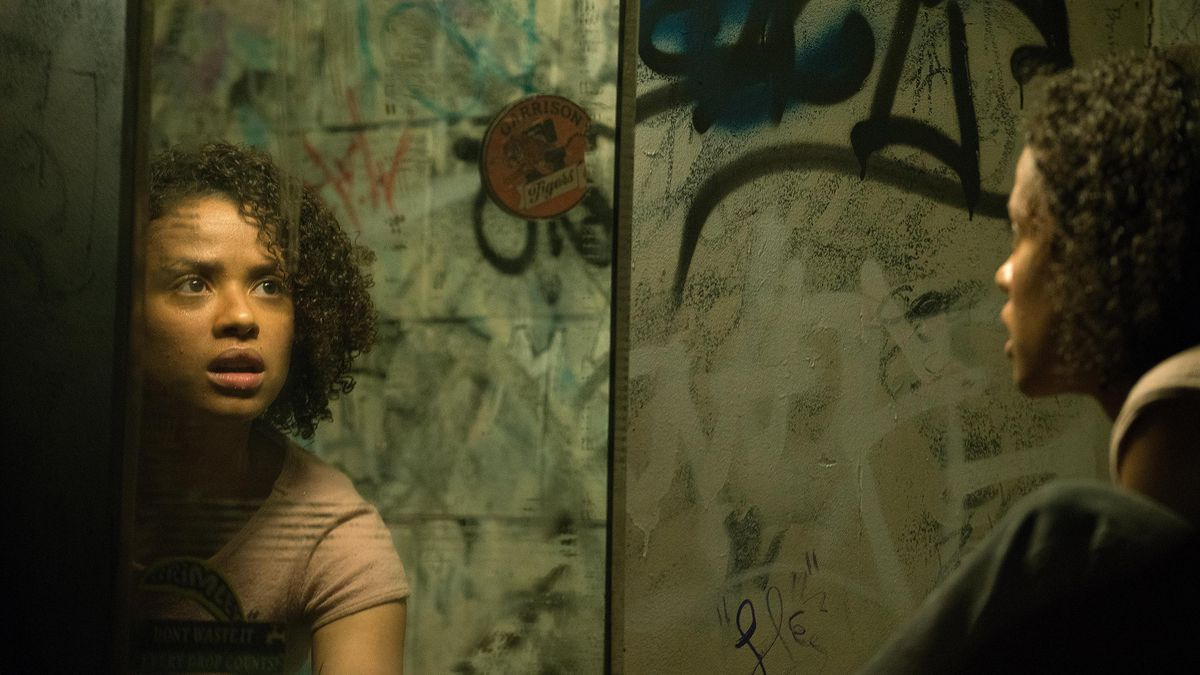 Gugu Mbatha-Raw facing herself in the mirror in Fast Color.