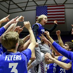 Dixie teammates hold up Matt Cooper while celebrating winning the 4A boys basketball championship title at the Dee Events Center in Ogden on Saturday, Feb. 29, 2020.