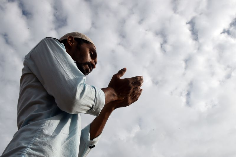 A Sri Lankan Muslim man offers Eid al-Fitr prayers at the Galle Face esplanade in Colombo on June 26, 2017.
