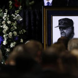 A picture of LaVell Edwards sits near the podium at a public memorial service for former Cougar football coach LaVell Edwards at the Provo Convention Center on Friday, Jan. 6, 2017.