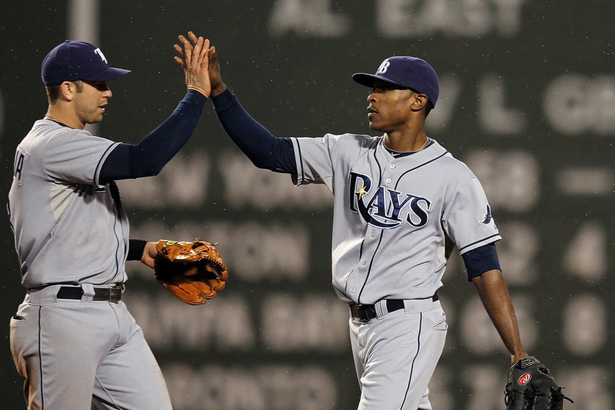 BOSTON, MA - SEPTEMBER 15:  Evan Longoria #3 of the Tampa Bay Rays and B.J. Upton #2 of the Tampa Bay Rays celebrate a 9-2 win over the Boston Red Sox at Fenway Park September 15, 2011 in Boston, Massachusetts. (Photo by Jim Rogash/Getty Images)