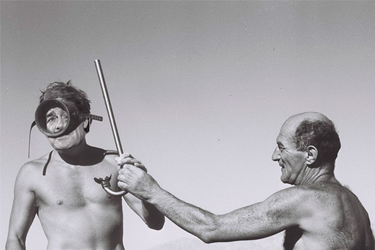 Hayden Fry and then-assistant Barry Alvarez go skin-diving for snapping turtles, 1983