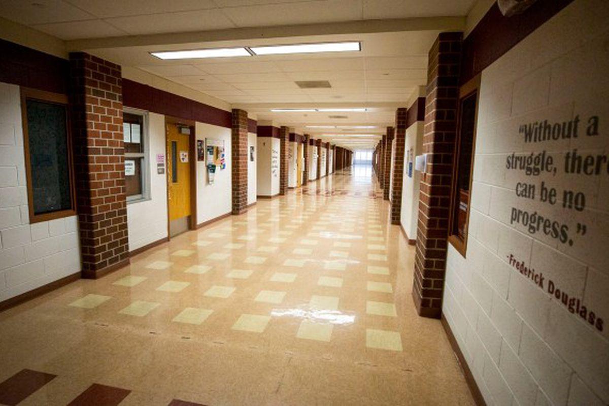 An empty high school hallway.