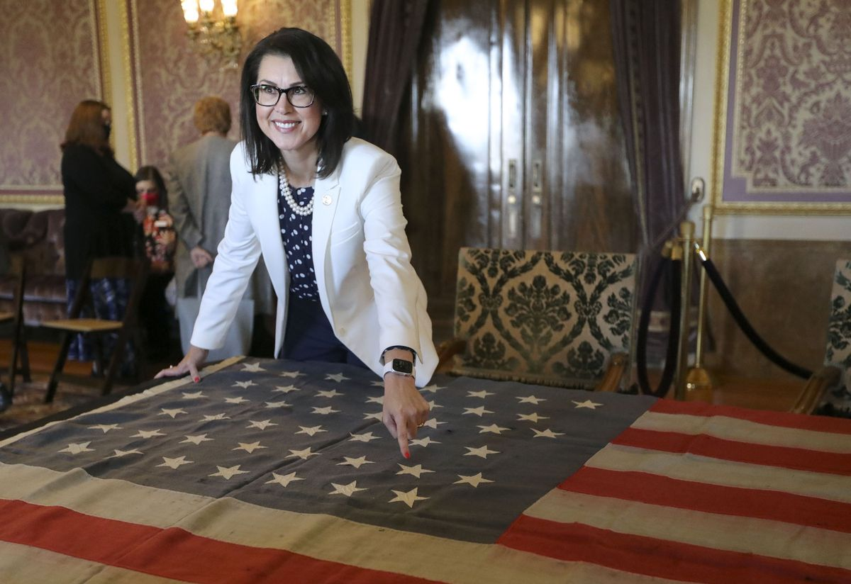 Lt. Gov. Deidre Henderson points to the 45th star, representing the state of Utah, on the original 45-star flag that flew over the U.S. Capitol when Utah became a state in 1896, at the Capitol in Salt Lake City on Tuesday, May 11, 2021. Jan Benson and his family gifted the flag to the state, and it will be displayed on the first floor of the Utah Capitol.