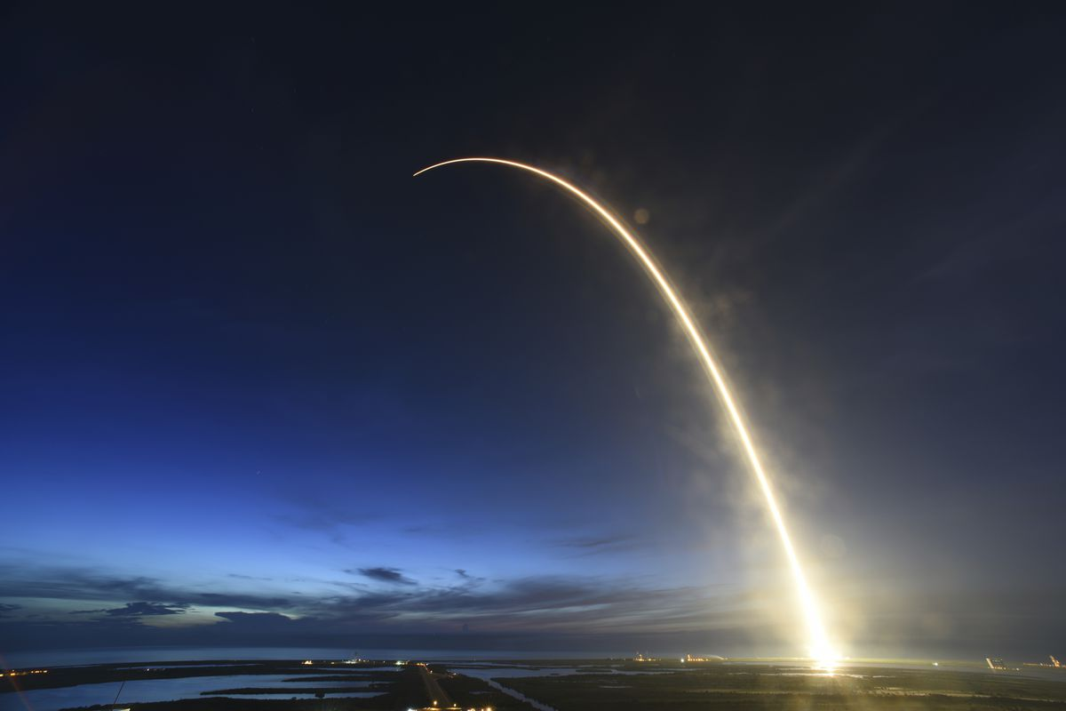 A SpaceX Falcon 9 rocket launches just before dawn Friday, June 29, 2018 at Launch Complex 40 at Cape Canaveral, Fla.   The used Falcon rocket blasted off before dawn, hauling nearly 6,000 pounds (2,700 kilograms) of cargo, including the spherical AI bot