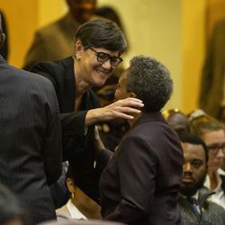 Mayor Lori Lightfoot hugs her wife, Amy Eshleman, before the start of her first Chicago City Council meeting at City Hall, Wednesday, May 29, 2019.
