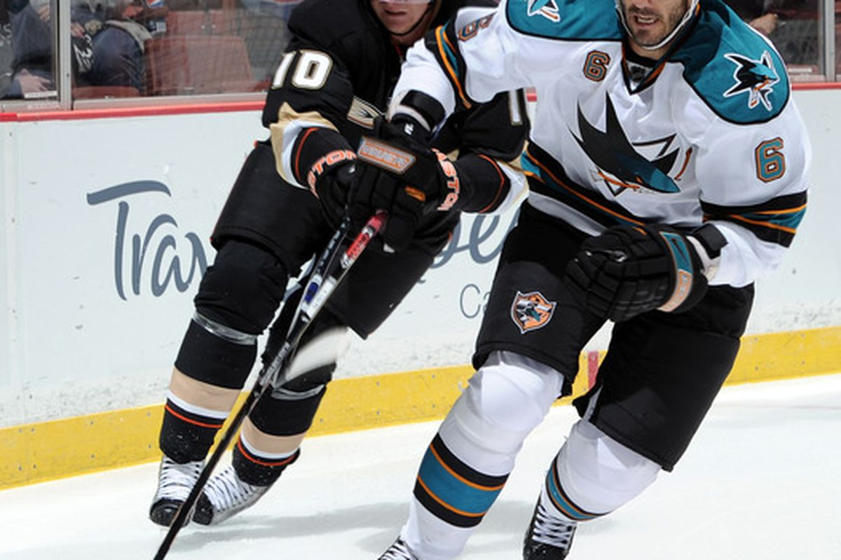 ANAHEIM CA - SEPTEMBER 22:  Andreas Lilja #6 of the San Jose Sharks is chased by Corey Perry #10 of the Anaheim Ducks during the first period at Honda Center on September 22 2010 in Anaheim California.  (Photo by Harry How/Getty Images)