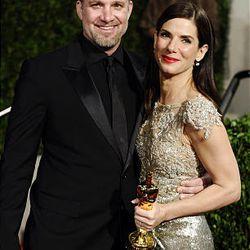Sandra Bullock and Jesse James arrive at the Vanity Fair Oscar party on Sunday.