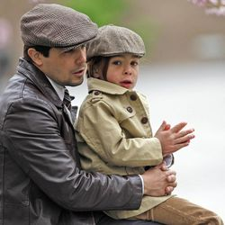 Javier Jimenez and his son, Esteban, enjoy listening to conference outside during The Church of Jesus Christ of Latter-day Saints' Saturday afternoon session of the 183rd Annual General Conference Saturday, April 6, 2013, in Salt Lake City.