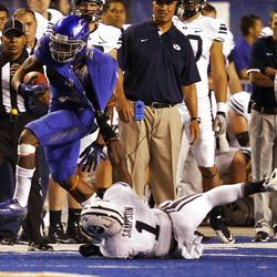 Joe Sampson of the Brigham Young Cougars pulls down D.J. Harper of the Boise State Broncos during NCAA football in Boise, Thursday, Sept. 20, 2012.