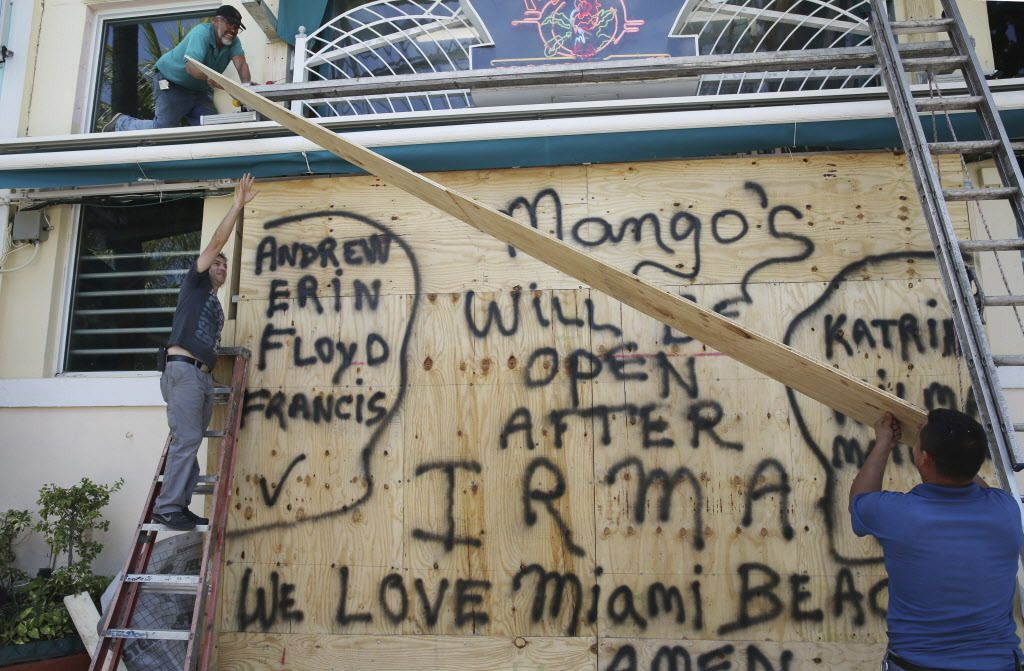 Workers shutter Mango's Tropical Cafe in Miami Beach, Florida, on Thursday, Sept. 7, 2017. The National Hurricane Center issued a hurricane watch for the Florida Keys and parts of South Florida, the first of perhaps many watches and warnings along the Sou
