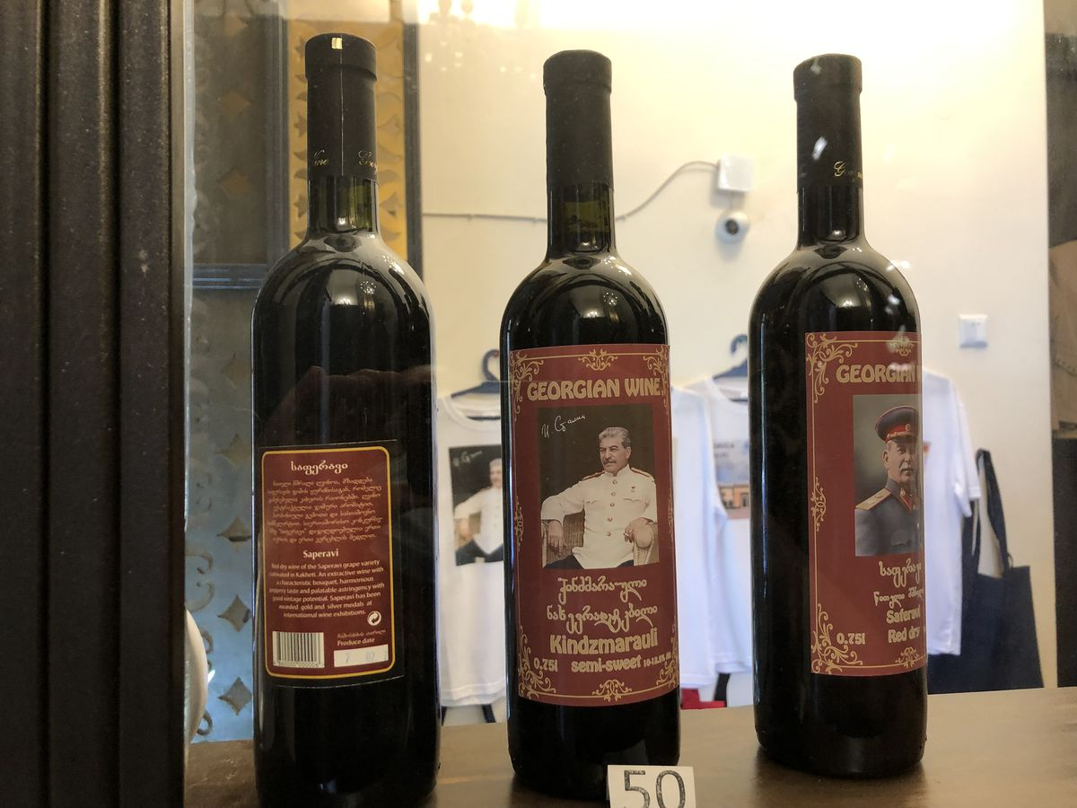 Wine bottles bearing the likeness of the dictator whosent a million or more of his countrymen to their deaths are sold in the gift shop at the Joseph Stalin State Museum.