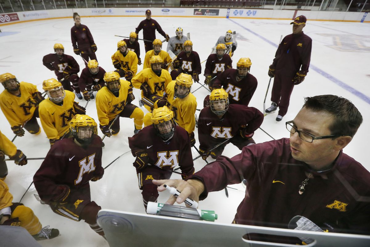 Minnesota coach Brad Frost go over plays with his team during practice.The University of Minnesota women's hockey team practiced Tuesday September 30 , 2014 at Ridder Arena in Minneapolis ,MN. ] Jerry Holt Jerry.holt@startribune.com