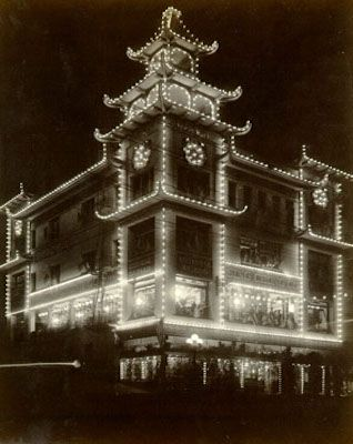 The Sing Chong building illuminated during the Portola Festival, 1909.