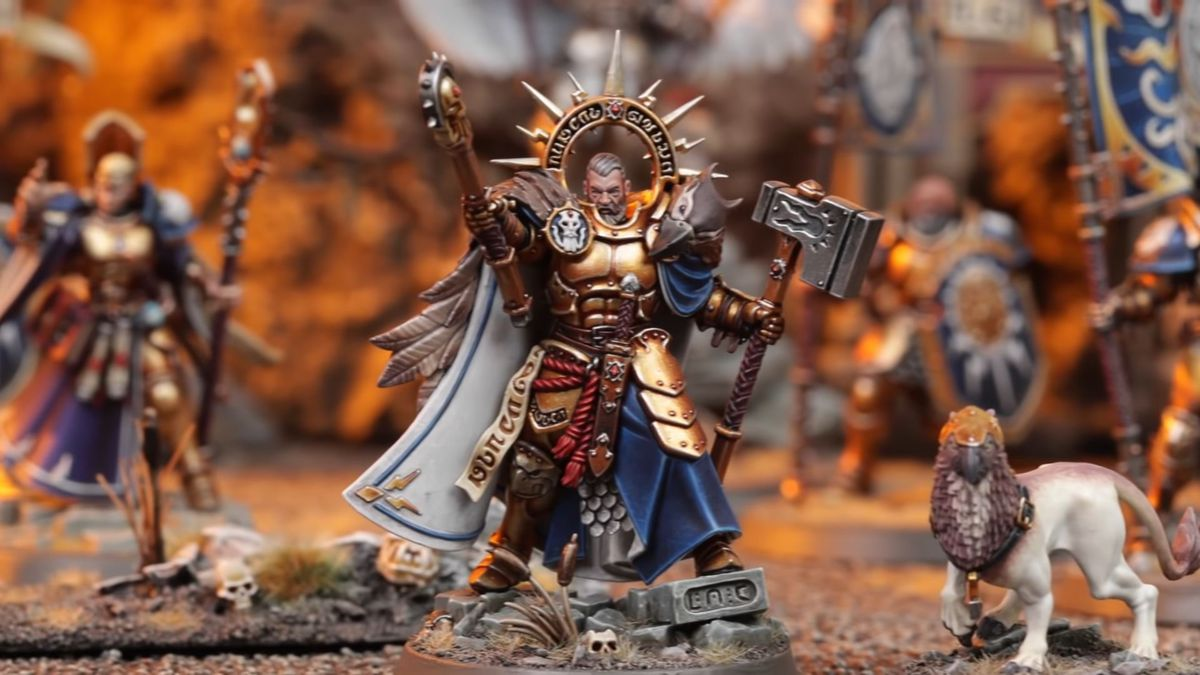A Stormcast Eternal raises a staff and a hammer, flanked by a drake.