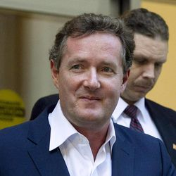 """FILE - In this Dec. 20, 2011 file photo, Piers Morgan, host of CNN's """"Piers Morgan Tonight,"""" leaves the CNN building in Los Angeles. Former U.S. President Bill Clinton's convention speech nominating President Barack Obama for a second term left Morgan star-struck: """"Already the best speech of either convention,"""" the prime-time talk show host tweeted. """"An oratorical genius right up there with Churchill, Kennedy, MLK and Mandela."""""""