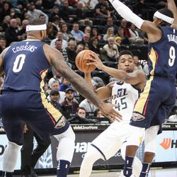Utah Jazz guard Donovan Mitchell (45) drives the key around New Orleans Pelicans guard Rajon Rondo (9) as Utah hosts New Orleans at Vivint Arena in Salt Lake on Friday, Dec. 1, 2017.